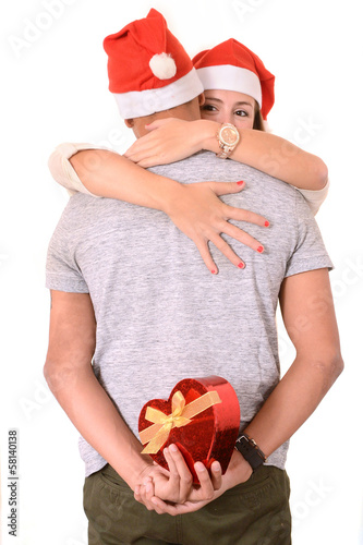 Young Couple hugging and Christmas Present