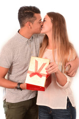 Young Beautiful Woman receiving Present and kissing handsome man