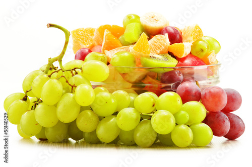 Fruit salad bowl isolated on white