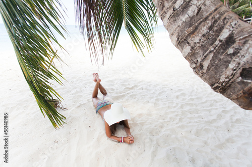 Young girl resting on a beach
