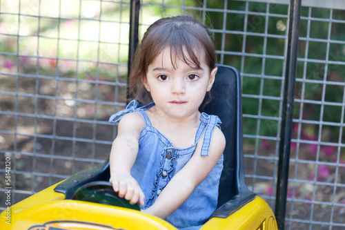 Little girl plays a driver