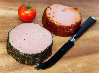 Two meat pastes, special knife and tomato