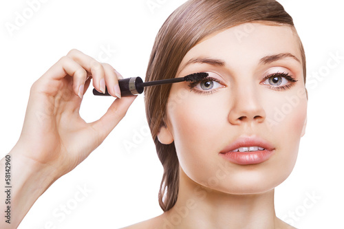 cute woman with mascara brush