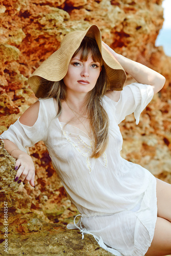 beautiful woman wearing straw hat