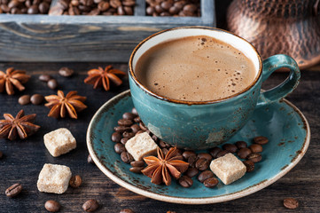 Cup of coffee with sugar and spices