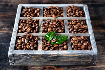 Roasted coffee grains in an old wooden box