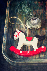 Christmas tree toy rocking horse and  antique clock  on a chain