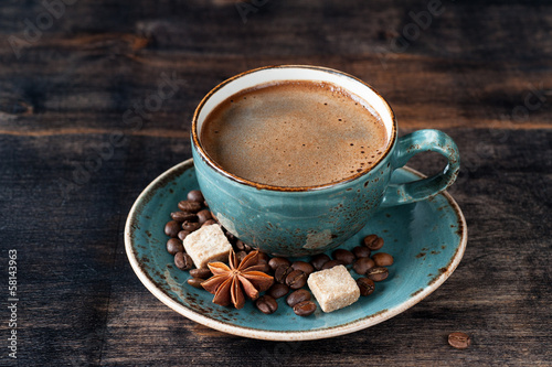 Fotobehang Cafe Cup of coffee with sugar and spices on dark wooden background