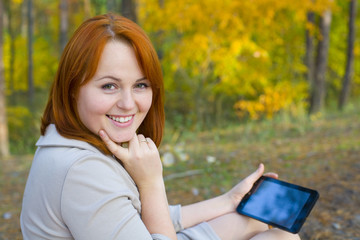 Portrait of beautiful girl with the smartphone