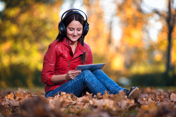Girl Listening Music In The Autumn Sunshine