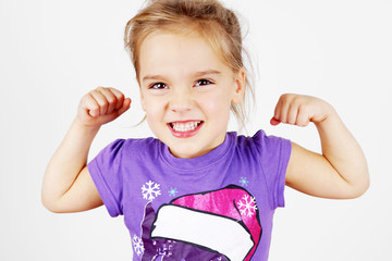 Blond little girl with muscle