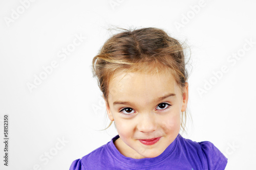 Mischievous little blond girl