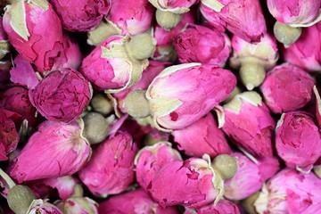 Dried rosebuds background texture closeup