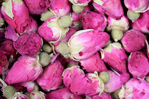 Dried rosebuds background texture closeup