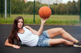 Beautiful Charming Woman Holding Basketball In Hand