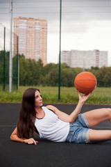 Beautiful Woman Holding Basketball In Hand