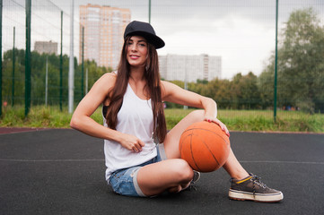 Sexy Woman Holding Basketball In Hand