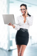 Young business woman with laptop and mobile