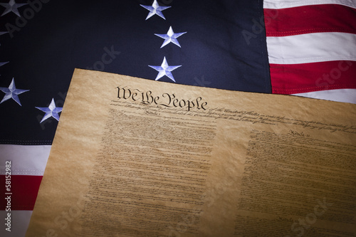 US flag with thirteen stars and the constitution