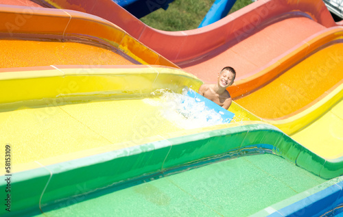 child  having fun in aqua park