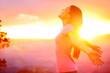 Leinwandbild Motiv Free happy woman enjoying nature sunset