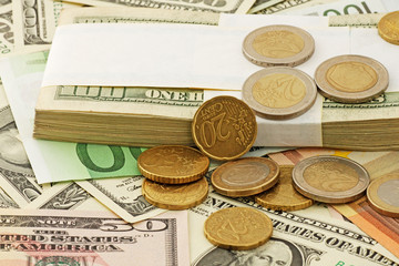 euro cents on euro and dollars banknotes