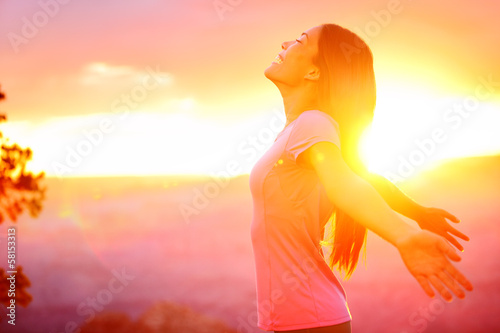 Free happy woman enjoying nature sunset - 58153313