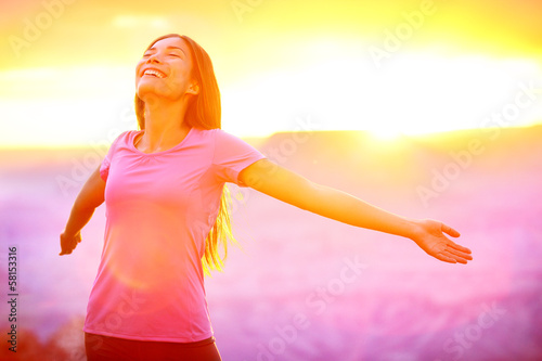 canvas print picture Happy people - free woman enjoying nature sunset
