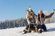 Two girlfriends sledge downhill in wintertime