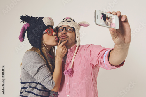Dating young couple in love taking a picture of themselves