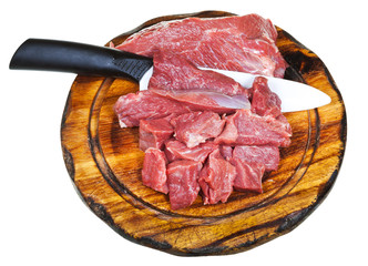 top view of cut raw meat on wooden board