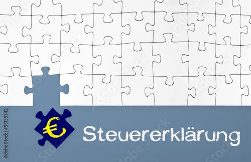 Puzzle in Blau mit Steuern