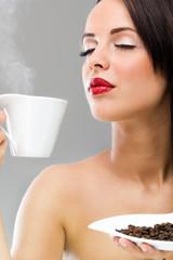 woman enjoys at morning coffee