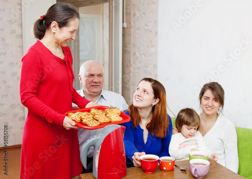 happy  family drinks tea at home