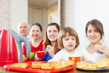 three generations family drinks tea