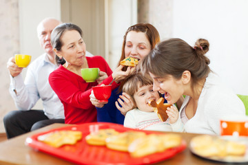 happy multigeneration family communicate over te
