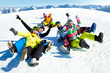 canvas print picture - friends slide downhill together on mountain holiday
