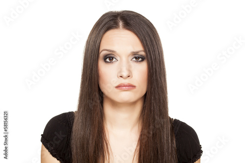 portrait of confused girl posing on a white background