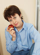 Nice woman with an apple