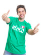 Laughing mexican sports fan showing both thumbs up