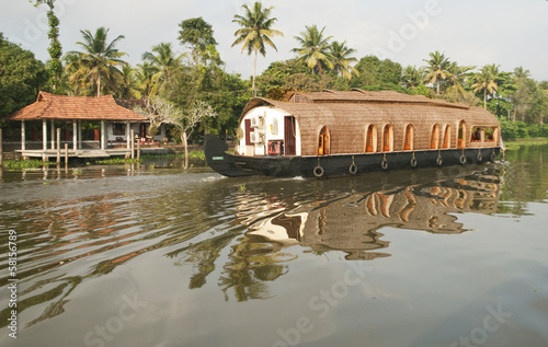 houseboat in backwaters near trees