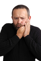 man with a toothache on white background
