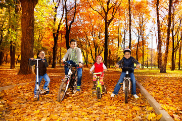 Group of boys and girls on bikes in park