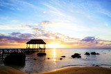 Fototapety Jetty silhouette against sunset in Mauritius