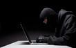 Computer hacker in a balaclava - 58160591