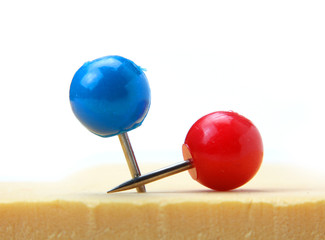 Two round push pins