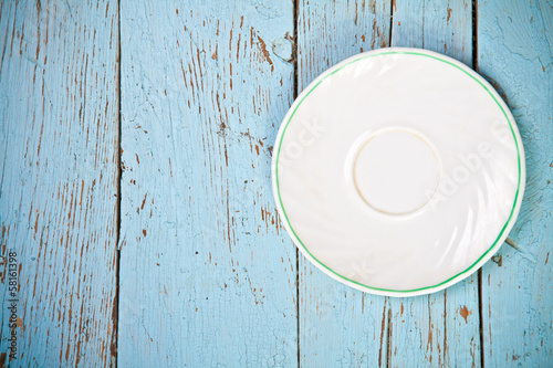 ceramic dish on wooden boards top view