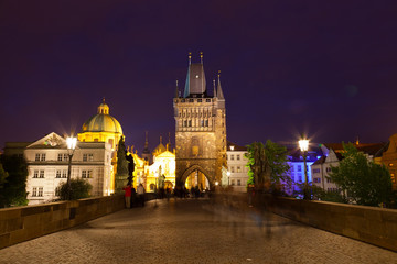 Tourists near Charles bridge in Prague at night