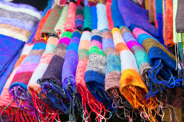 Pile of gentle folded shawls (scarfs) at the market,  Nepal.