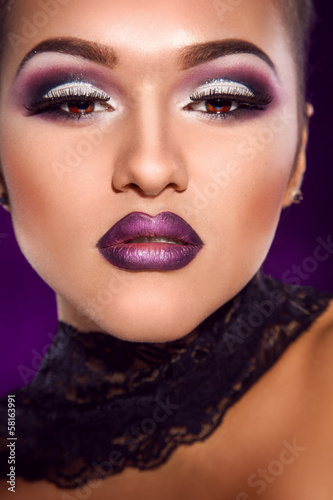 Close up portrait of sexy female with professional make up